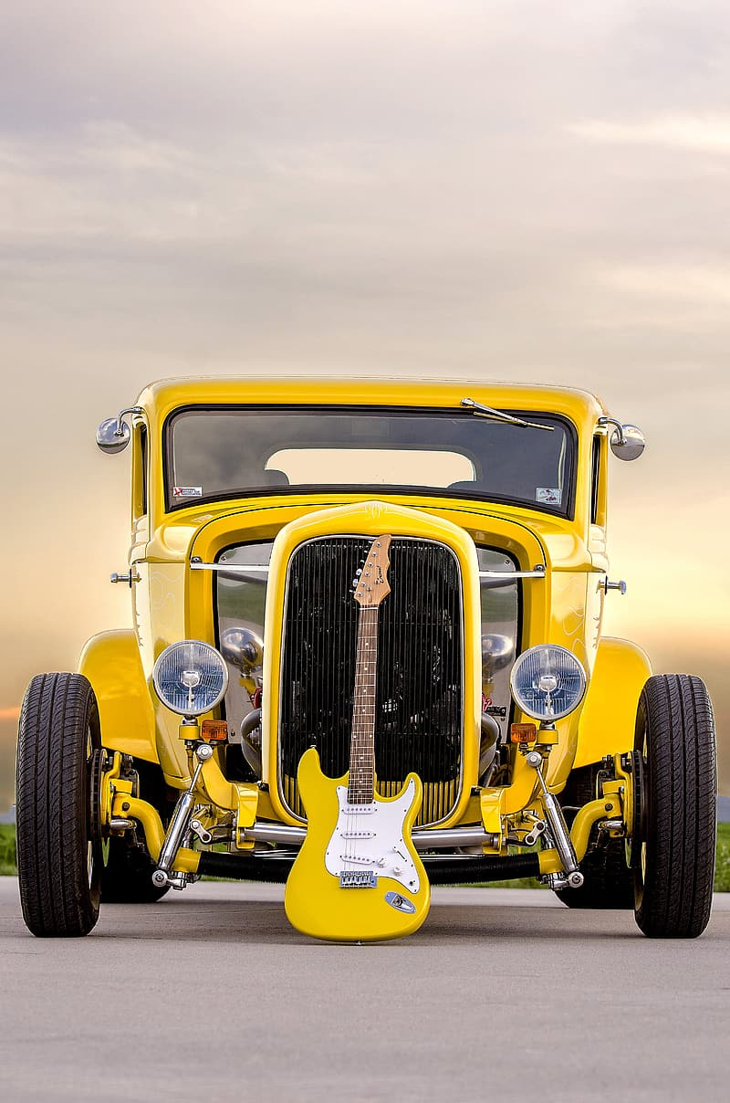 Yellow HotRod with electric guitar on front