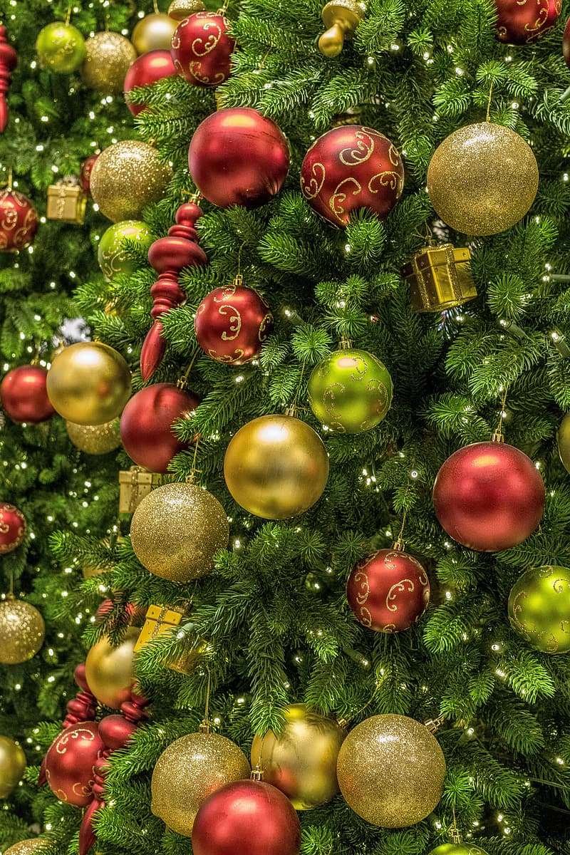 Green Christmas tree with ornaments and baubles