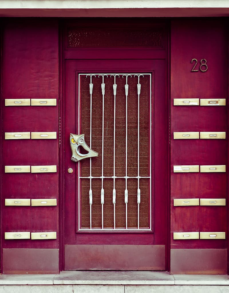 Red and white wooden panel door closed