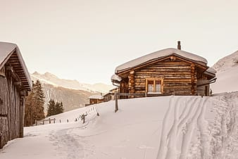 Brown wooden house covered snows