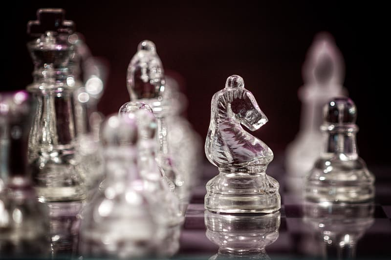 Clear glass chess piece on table