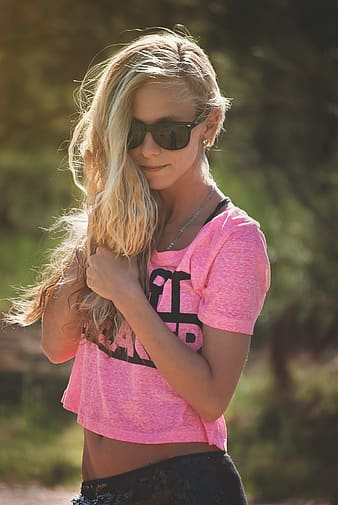 Woman in pink shirt and black bottoms