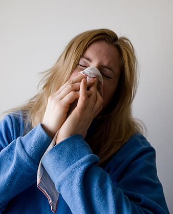 Woman covering her nose with handkerchief
