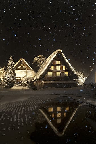 Snowy house during night