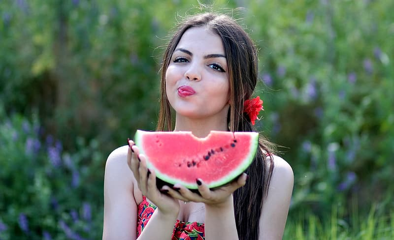 Woman holding watermelon at daytime