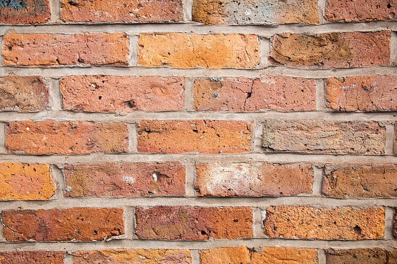 Close-up photo of brown concrete wall bricks