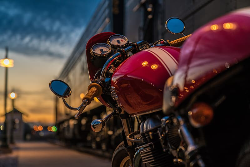 Selective focus photography of red motorcycle