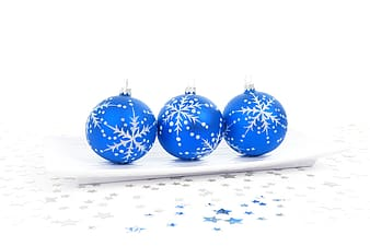 Three baubles with snowflakes accents on rectangular plate