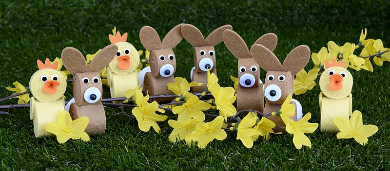 Ducks and rabbits decors on grass