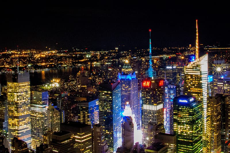 Aerial shot of high-rise buildings with lights during nighttime