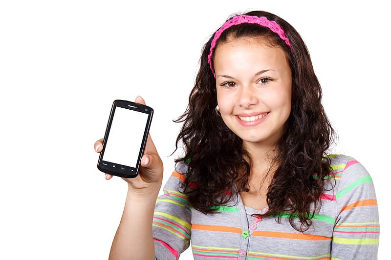 Woman holding black smartphone while smiling