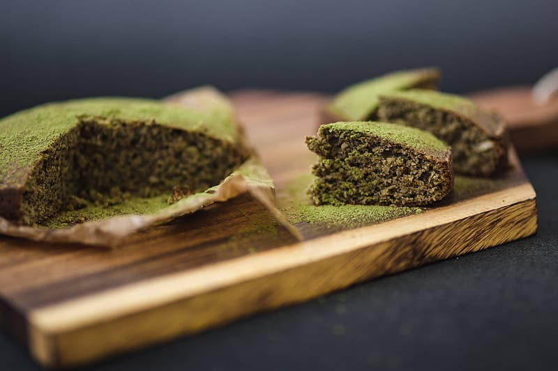Delicious homemade matcha cake on a wooden board