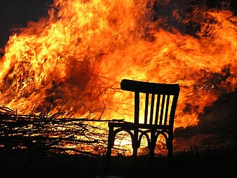 Photo of chair near burning trees