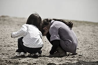 Photo of two girl's in gray sand