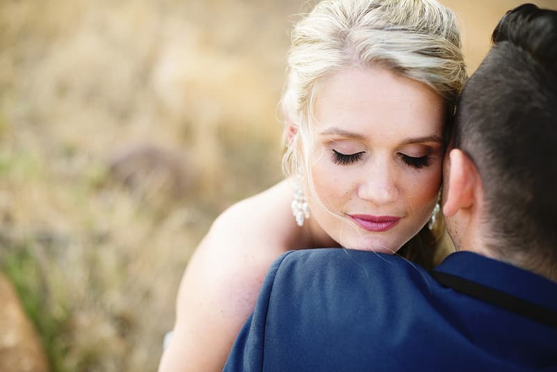 Couple hugging on selective focus photo