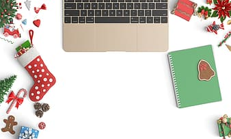 Flat lay photography of 2016 gold MacBook Pro beside green notebook