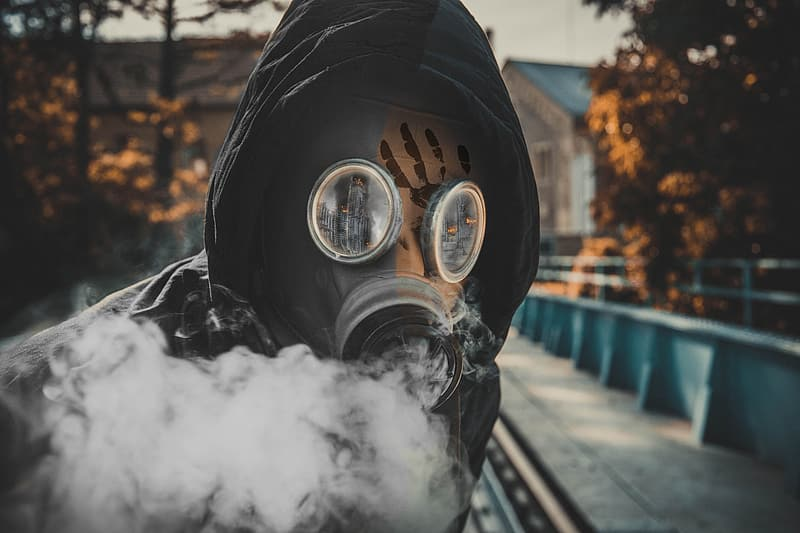 Person in black gas mask