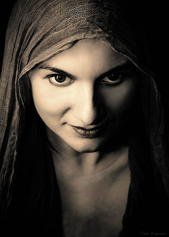Photo of woman in gray headscarf and black top