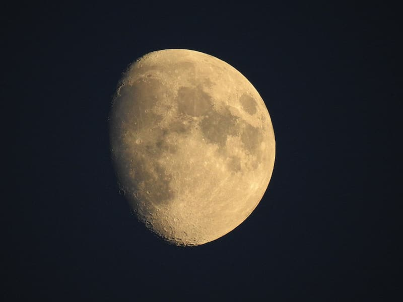 Yellow moon in black background