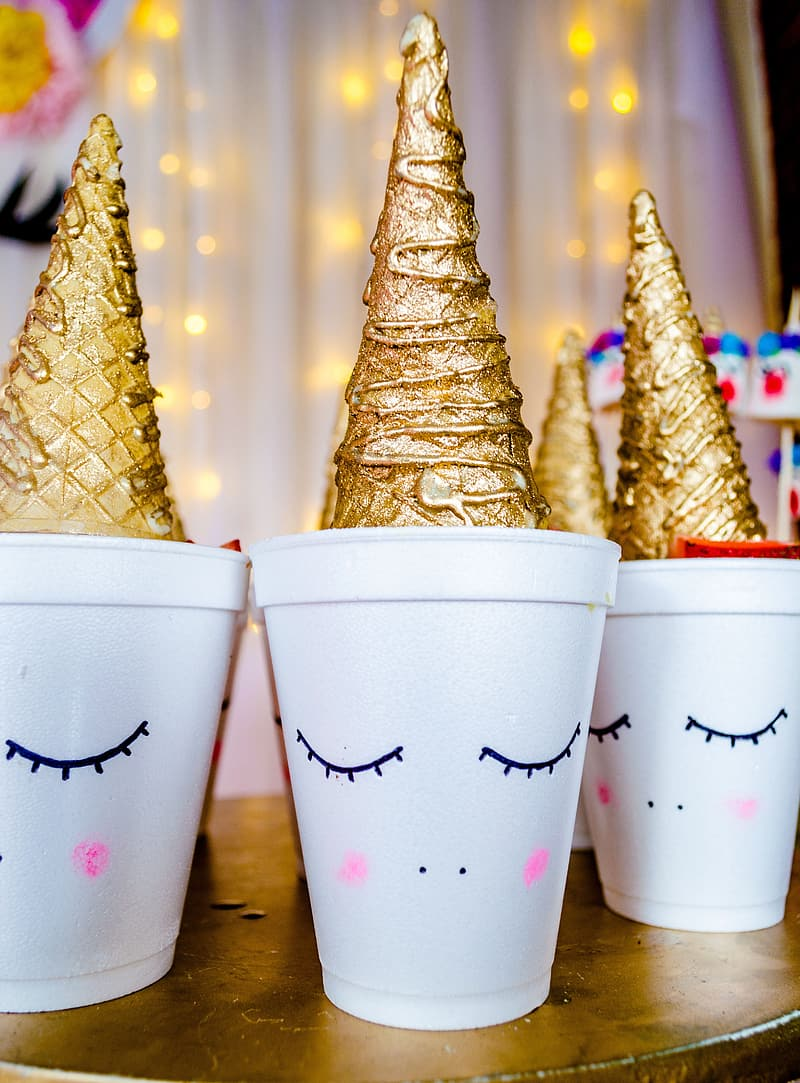 Two white and gold christmas tree print cups