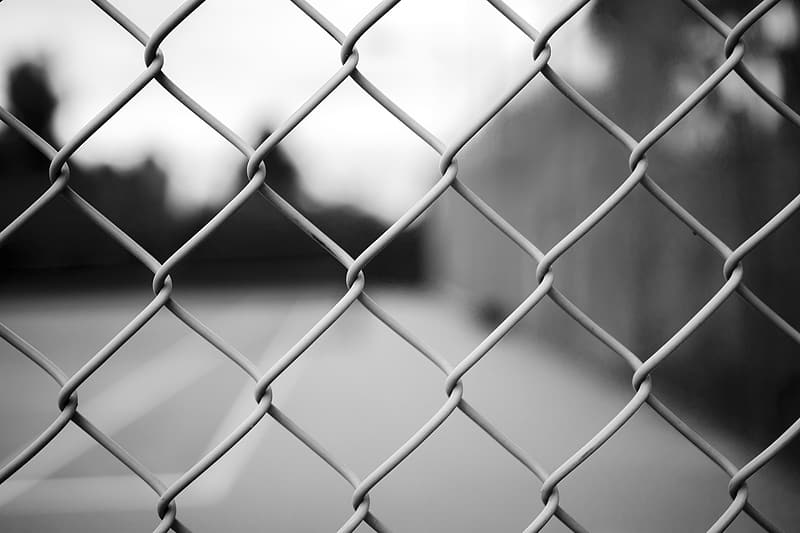 Grayscale photography of chain-link fence