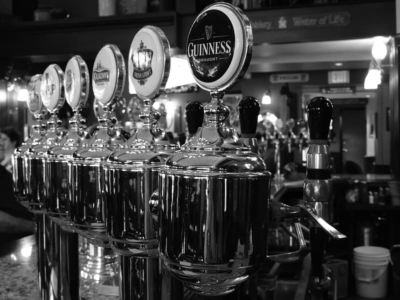 Beverage dispenser on grayscale photography