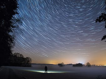 Time lapse photography of stars during winter