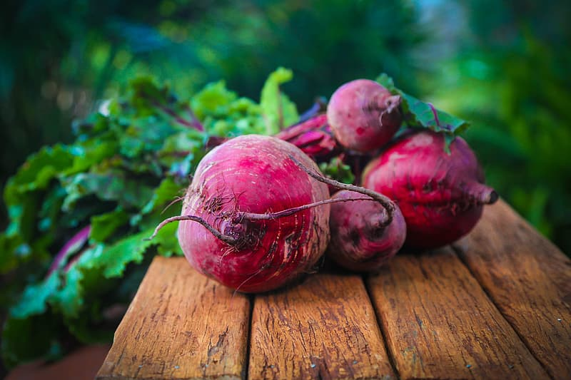 Red beet on brown wooden surface