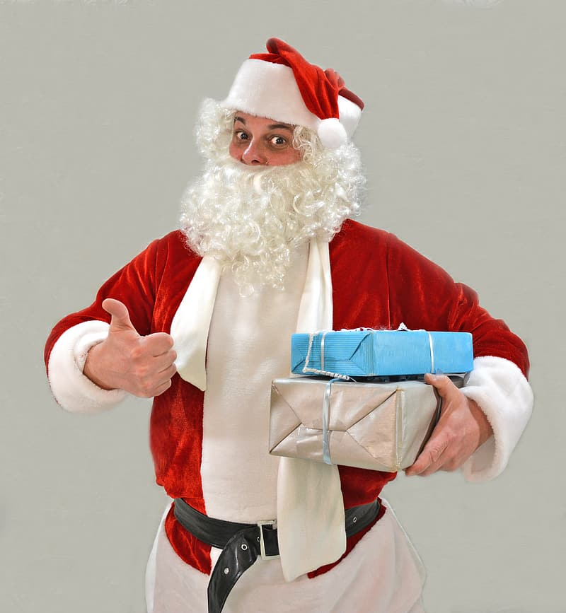 Man in Santa Claus costume holding gift boxes