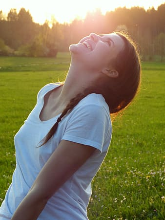 Woman smiling heads up