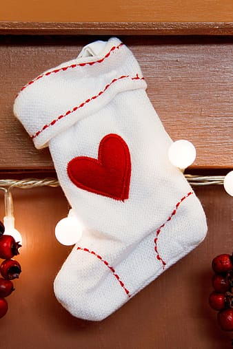 Hanged white and red heart-embroidered Christmas stocking
