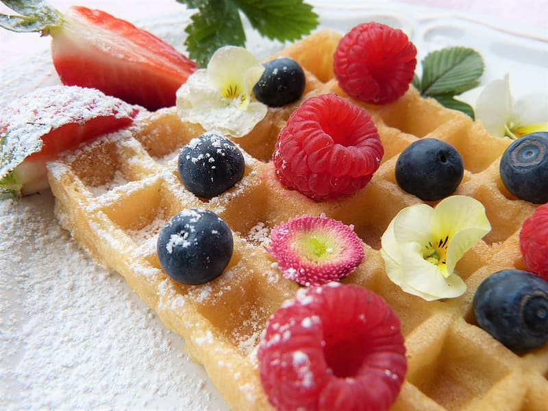 Photo of baked waffle with blackberries and sliced strawberries