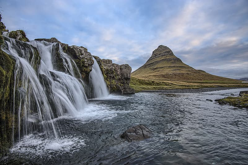 Photography of waterfall with brown mountain on background
