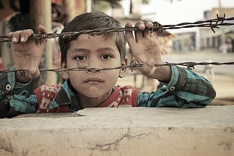 Boy holding brown barbwire