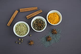 Assorted spices on white bowls