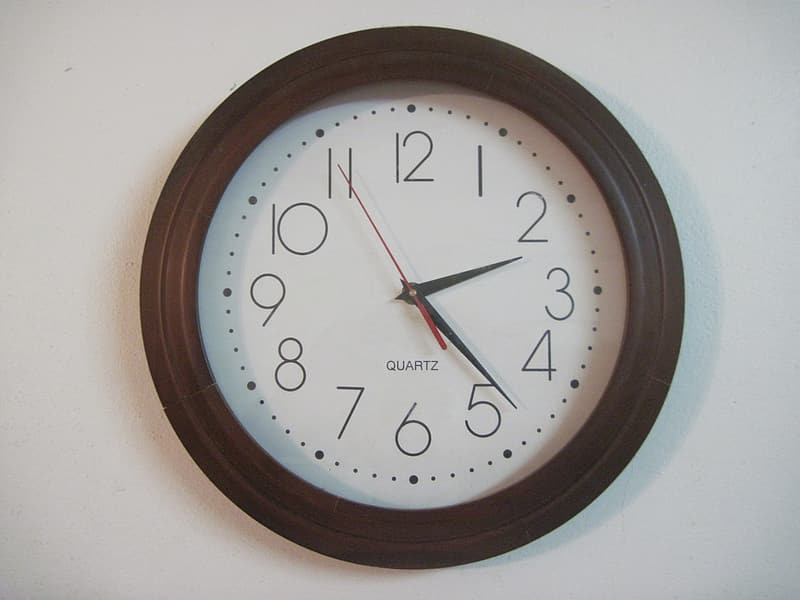Brown wooden round analog wall clock