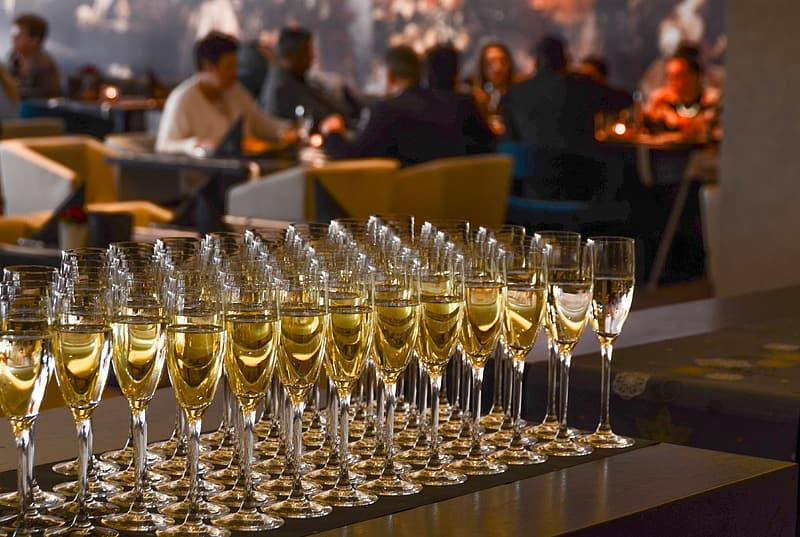 Shallow focus photography of flute champagne glasses