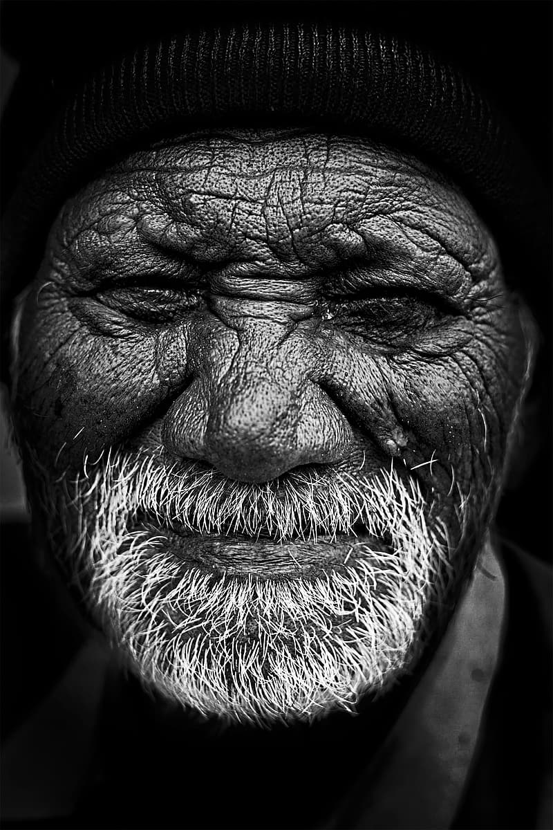 Grayscale photo of mans face