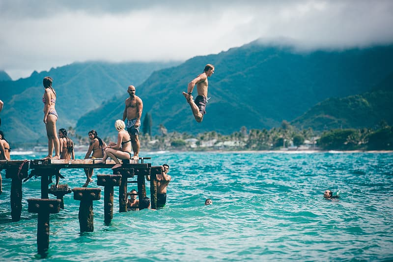 Man jumping unto body of water