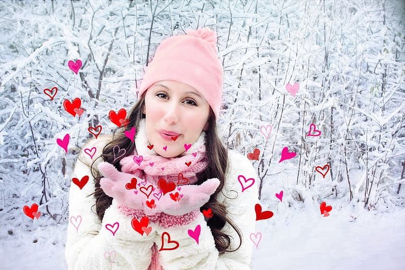 Woman in pink knit cap and winter jacket on snowy place during daytime