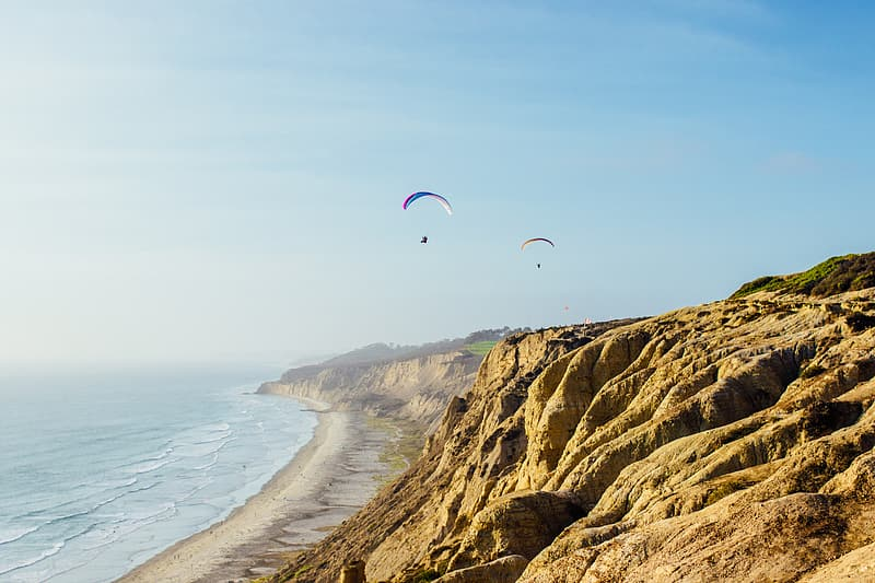 Two person doing paragliding during daytime