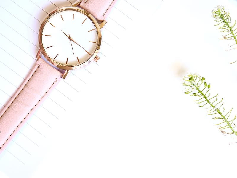 Gold analog watch with pink strap