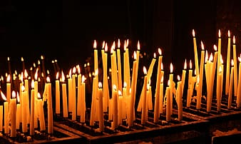 Lighted candles on black background