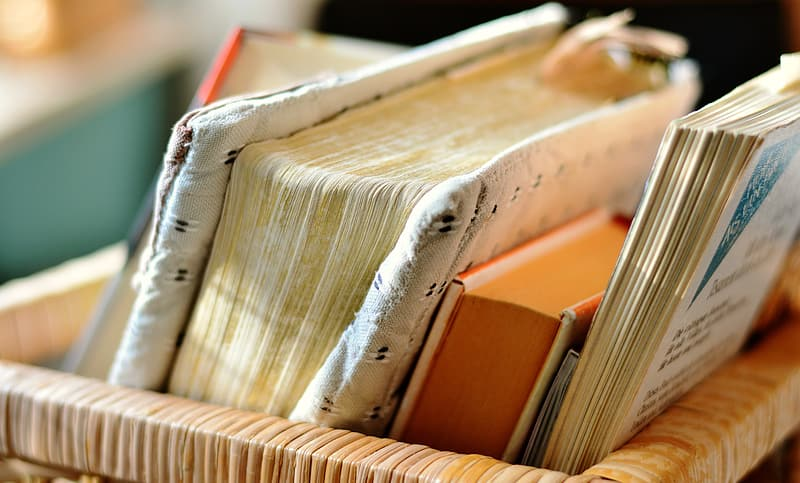 Closeup photo of filed books in basket