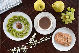 Overhead shot of fruit, coffee and biscuits