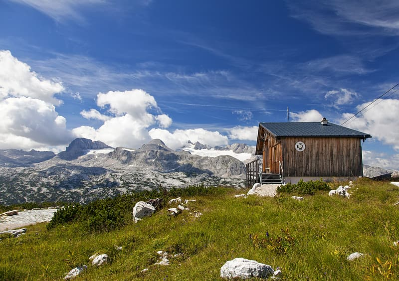 Brown wooden house on top of the mountain