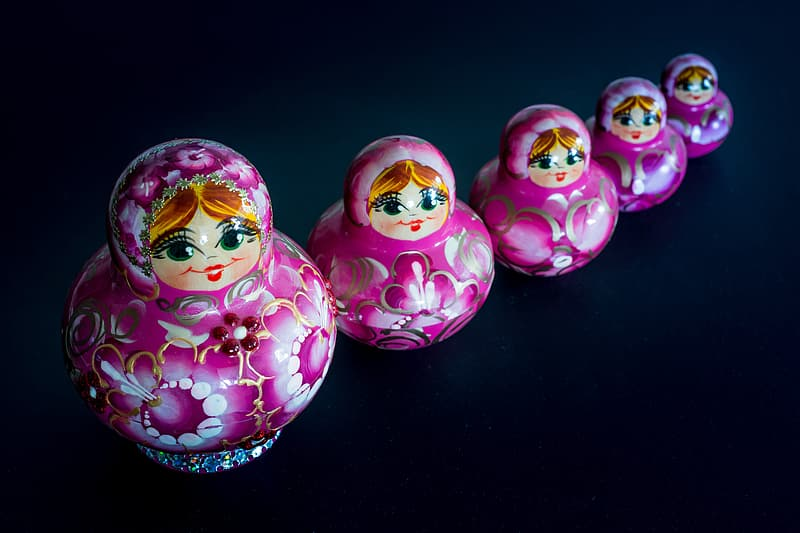 Matryoshka dolls on black surface