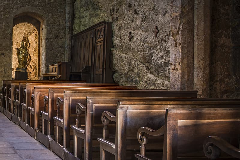 Empty brown wooden pews in church