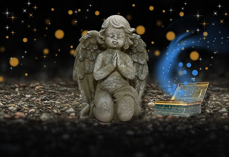Gray angel figurine on brown wooden table