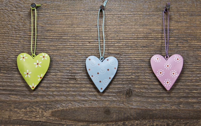 Three assorted-color heart pendant necklaces